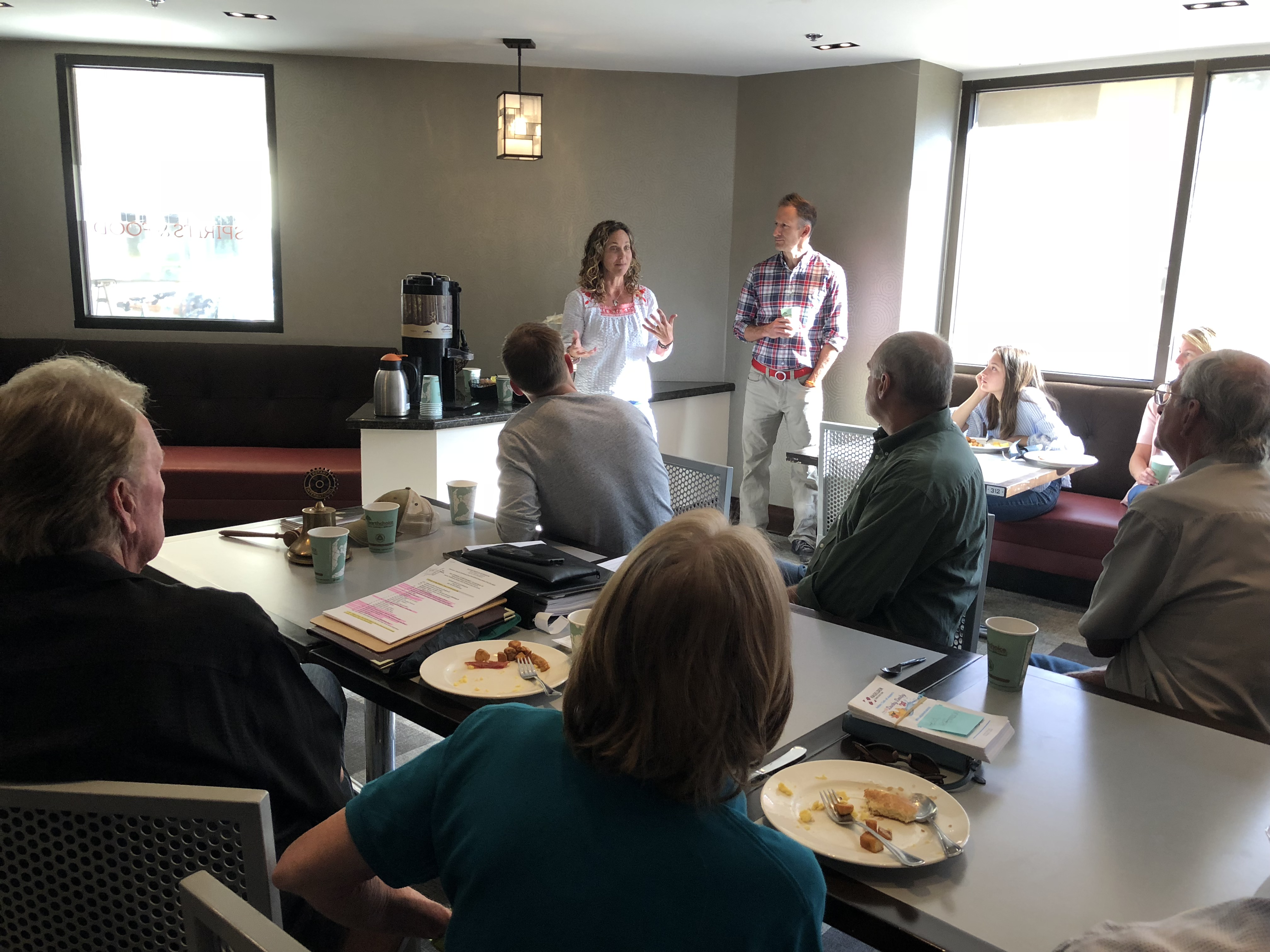 Megan and Scott Reimer of Jackson Honest Crunchy Snacks presenting to the Club